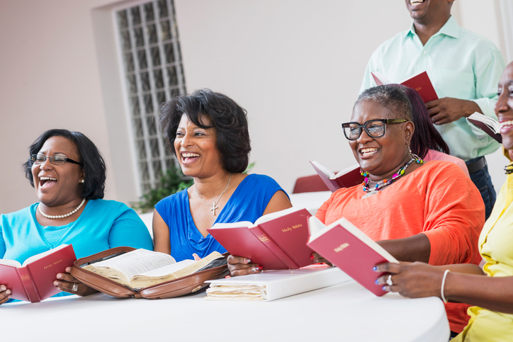 Group of mature black women in bible study meeting