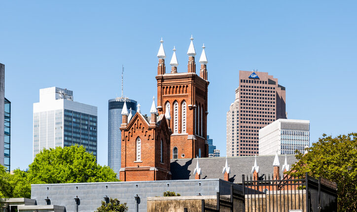 Capital Georgia city skyline cityscape during day with brick Catholic Shrine of the Immaculate Conception church, Westin Hotel, GP sign
